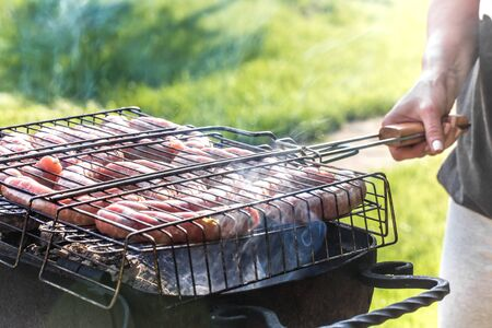Friends making barbecue and having lunch in the spring