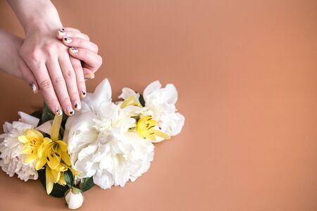 Closeup view of woman with beautiful hands on color background, space for text. Spa treatment