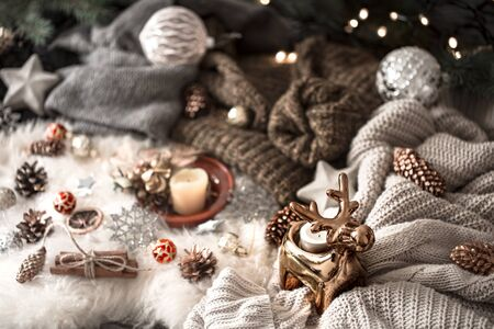 Christmas background. knitted sweater and christmas decoration on a light background, top view. Holiday still life