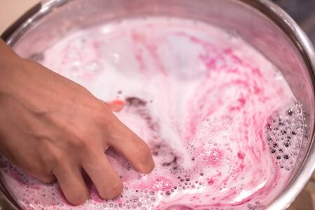Bright natural fizzy bath bomb dissolves in his hands. The concept of natural body care Stock fotó