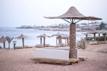 Empty beautiful beach with umbrellas and sunbeds in Egypt . the concept of travel and recreation .
