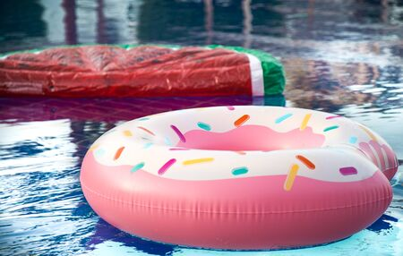 Inflatable accessories for swimming in the pool . In the form of inflatable watermelon and donut. The concept of summer vacation.