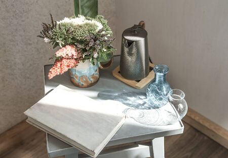 home chair with a beautiful flowerpot and decorative items . The concept of home comfort.