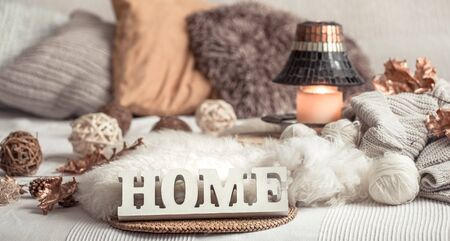 Still life home decor in a cozy house with wooden letters with the inscription home. The concept of decor and comfort .
