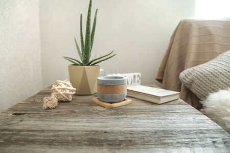 Home interior with decorative items on a wooden table. The concept of comfort and decor. 写真素材