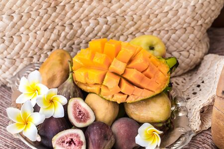 A plate of assorted fruits, sliced mango. The view from the top . Reklamní fotografie