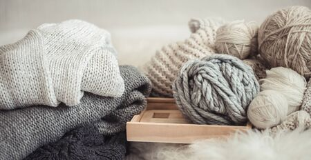 cozy background Wallpaper with a variety of threads for knitting. Close up. Stock Photo