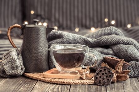 Cozy autumn still life with a Cup of tea in a homely atmosphere on a wooden table. Stock fotó