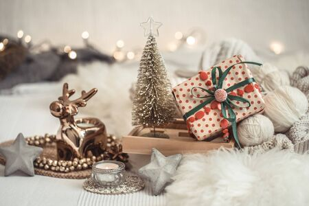 Christmas still life background with festive decor, in a cozy home atmosphere . The concept of celebrating New year and Christmas.
