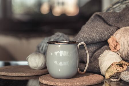 Cozy Autumn still life background with a beautiful Cup of hot drink . Close up.