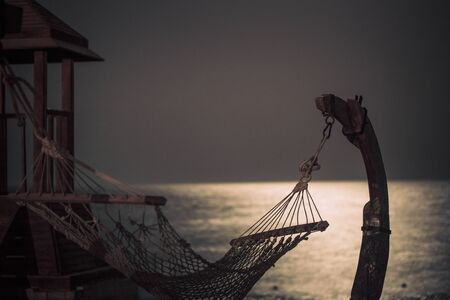 Beautiful beach with hammock in Egypt . the concept of travel and recreation .Night snapshot. Reklamní fotografie