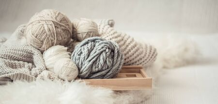 cozy background Wallpaper with a variety of threads for knitting. Close up.