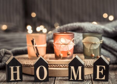 Cozy background with wooden letters with the inscription home . The concept of home atmosphere and comfort.