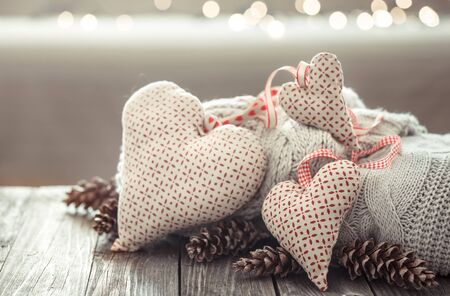 Cozy background on a wooden background with decorative objects hearts . St. Valentine concept decoration card.