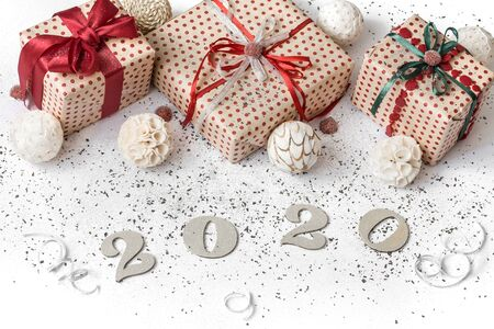 New year 2020 white festive background with gift tied with red ribbon. New year 2020 concept. . Copy space.