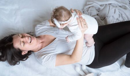 portrait of mom with cute little newborn girl. The concept of motherhood and family. Stock fotó