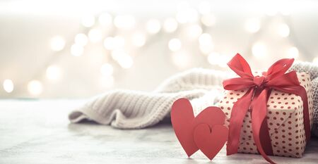 Background holiday, gift in a beautiful box with a heart . Valentines day. The concept of love and relationships.