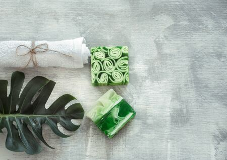 Spa composition with body care items and plants on a light background. The view from the top. 写真素材