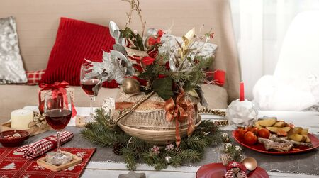 Beautifully decorated Christmas table in the living room. With the objects of holiday decor. The concept of a family holiday. Reklamní fotografie