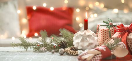 Beautifully decorated Christmas table in the living room. With the objects of holiday decor. The concept of a family holiday.
