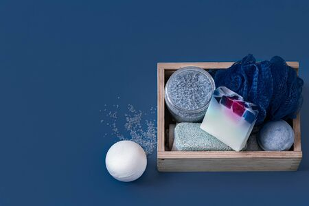 Different body care items on blue background, Spa care and hygiene concept .