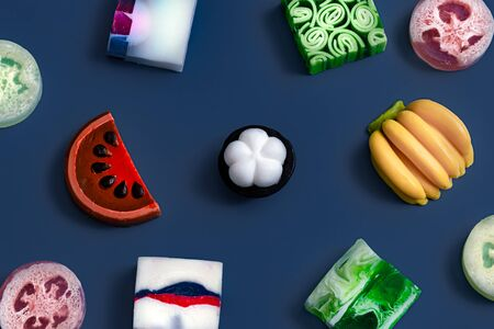 Bright handmade soap in the form of fruit on a blue background . The concept of objects. Trend color.