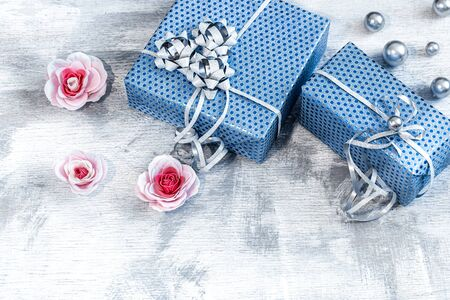 Blue gift box on a light wooden background . Valentines day, holiday and gifts. Back background.