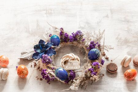Stylish composition with an Easter wreath and eggs trend blue. The concept of Easter decorations and celebration.