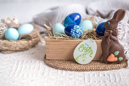 Easter still life with blue eggs, holiday decor . Easter cozy mood.