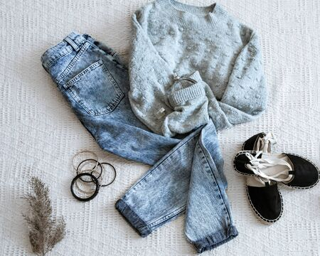 Set with fashionable womens clothing jeans and sweater, shoes and accessories . Top view, flat lay. Banco de Imagens
