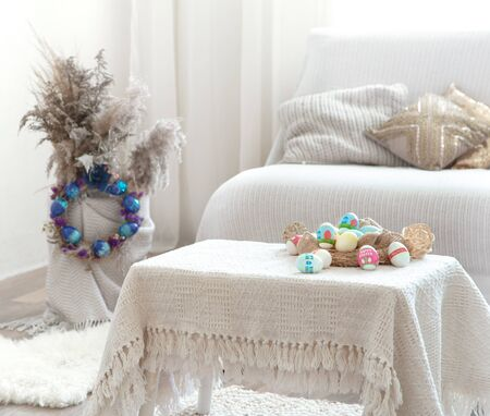Home cozy interior with Easter decor on the table. The concept of Easter holidays. Home entertainment