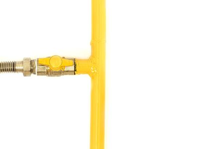 Yellow gas pipe with a valve. White background. Space for text.