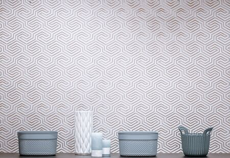 Interior design with decorative items on the table. Beautiful baskets and decorative elements on a light wall background. Stockfoto