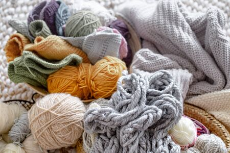 Different yarn for knitting in pastel and bright colors. Close- up , abstract background. The concept of Hobbies and crafts . Creative ideas.
