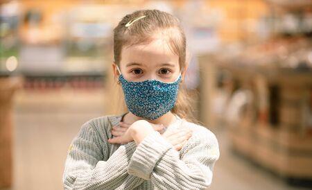 Coronavirus concept .A little girl wears a mask on her face during a virus epidemic
