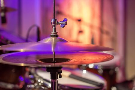 Drums, cymbals, hi hat on a beautiful background in the recording Studio. Room for musicians ' rehearsals. The concept of musical creativity and show business.