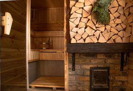 Interior of a wooden Russian bath with traditional items for use. Healthy lifestyle and Spa treatments.
