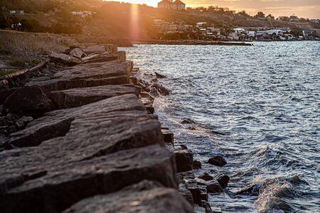 Beautiful sea at sunset near the rocky shore . Nature composition Фото со стока