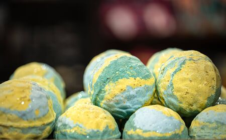 Handmade cosmetics, salt bright scented bath bombs. The concept of body care.