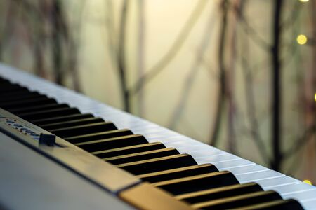 Piano keys on a beautiful colored background. Close up.