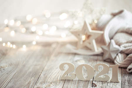 New year 2021 holiday background with decor. Blurry lights in the background. The concept of the celebration.