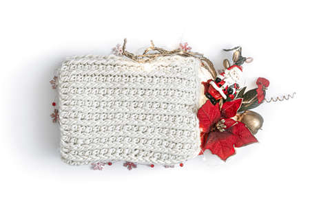 Christmas composition with poinsettia, decor and knitted element in the center on white isolated.