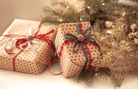 Beautifully wrapped christmas gifts with decorative star close up.