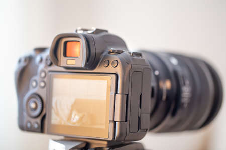Close up of a professional digital camera on a blurred background.