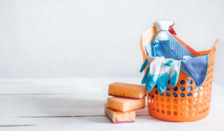 Close up set of home cleaning products in a bright basket. Means for maintaining cleanliness.