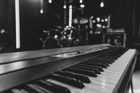 Close up of piano keys on blurred background with bokeh. Stock Photo