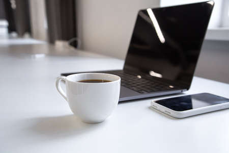 A cup of black coffee at the workplace in the office close-up. Stockfoto