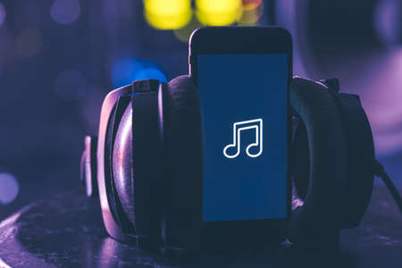 Music background with phone and with music icon, modern technology concept, listening to music.