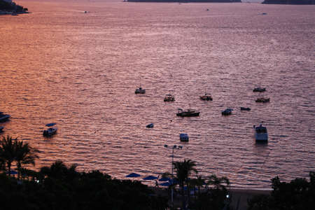 Boats at beach sunset