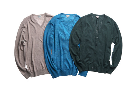 Three different color sweters; light gray, light blue and dark green.